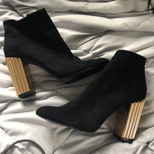 Black booties gold heel
